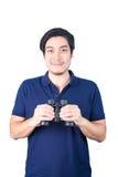 Asian guy holding binoculars, isolated on a white background. Stock Image