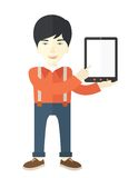 Asian guy holding a digital tablet Royalty Free Stock Photography