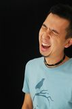 Asian guy laughing Stock Photo