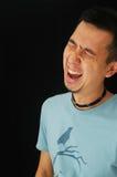Asian guy laughing Stock Photo