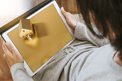Asian guy looking on digital tablet screen, looking for land and house concepts Royalty Free Stock Images