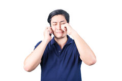 Asian guy with mobile phone in hand and crying, isolated on whit. Asian guy with mobile phone in hand speaking, crying, isolated on white background stock images