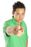 Asian guy pointing (focus on face) Stock Photos