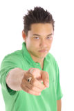 Asian guy pointing (focus on finger) Royalty Free Stock Photography
