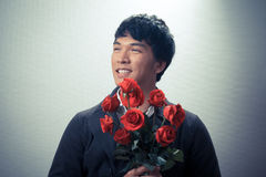 Asian guy with red roses in retro style Stock Photography