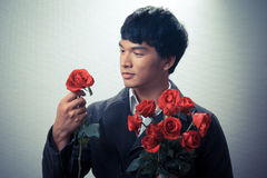 Asian guy with red roses in retro style Stock Photo