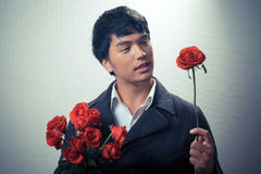 Asian guy with red roses in retro style Royalty Free Stock Photography