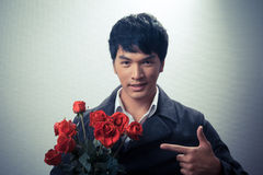 Asian guy with red roses in retro style Stock Image
