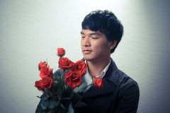 Asian guy with red roses in retro style Stock Images