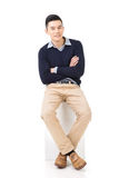 Asian guy sit. Handsome Asian guy sit pose, full length portrait isolated on white background stock photo