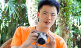 Asian guy traveller smile with SLR camera Stock Images