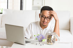 Asian guy using internet computer Stock Photography