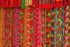 Asian hand made strands colorful beads at outdoor crafts market in Kathmandu, Nepal. Royalty Free Stock Photography