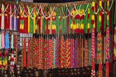 Asian hand made strands colorful beads at outdoor crafts market in Kathmandu, Nepal. Royalty Free Stock Images