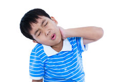 Asian handsome boy have a neck pain. Isolated on white backgroun. Asian child have a neck pain, his hand on neck, emotion feeling sign. Isolated on white Royalty Free Stock Photo