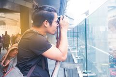 Asian handsome guy taking picture of Bangkok cityscape, Lifestyl Royalty Free Stock Photos