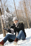 Asian handsome guy throwing snow in the air in garden Royalty Free Stock Image
