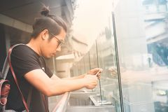 Asian handsome guy using smartphone with urban background, Lifes Stock Photos