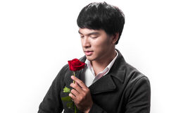 Asian handsome man hold the red rose with love Stock Photos