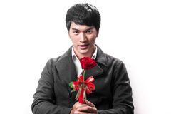 Asian handsome man hold the red rose with love Royalty Free Stock Image