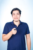 Asian handsome man with the keys of his new car, on blue background royalty free stock photography