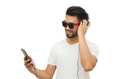 Asian handsome man with a mustache, smiling and laughing and usi. Ng smart phone to listen music with headphones ,Blurry and soft focus,vintage Stock Photos