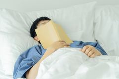 Asian handsome man Read books while sleeping. Man book cover Drowsiness causes sleep.The concept of adequate sleep. Good sleep. Asian handsome man Read books stock images