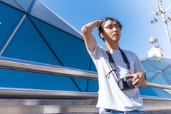 Asian handsome man traveling with a camera. royalty free stock photo