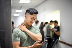Asian handsome men confused using smartphone | Guy tired while using smartphone stock photos
