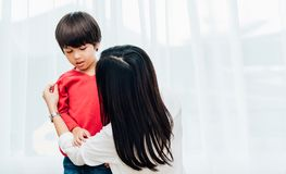 Asian happy beautiful mother getting dressed clothes on her kids. For going to school stock photos