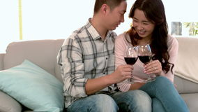 Asian happy couple drinking wine. At home stock video footage