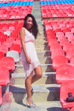 Asian Happy model posing at the stadium sitting on brigh Stock Images