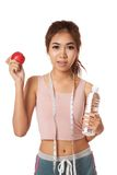 Asian healthy girl with apple , water and measuring tape Stock Photo