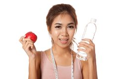 Asian healthy girl with apple , water and measuring tape Royalty Free Stock Images
