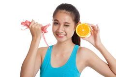 Asian healthy girl on diet with orange fruit and measuring tape Royalty Free Stock Photography