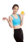 Asian healthy girl on diet with orange fruit and measuring tape Royalty Free Stock Photos