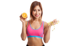 Asian healthy girl on diet with orange fruit and measuring tape Stock Images