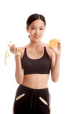 Asian healthy girl on diet with orange fruit and measuring tape Royalty Free Stock Image