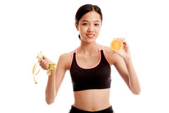 Asian healthy girl on diet with orange fruit and measuring tape Royalty Free Stock Photo