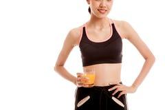 Asian healthy girl drinking  orange juice Stock Images