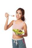 Asian healthy girl eating salad for diet. Isolated on white background Stock Images