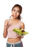 Asian healthy girl eating salad for diet Royalty Free Stock Photography