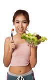 Asian healthy girl eating salad for diet. Isolated on white background Royalty Free Stock Image