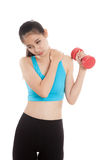 Asian healthy girl got shoulder pain with dumbbell Royalty Free Stock Images