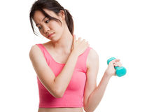 Asian healthy girl got shoulder pain with dumbbell. Stock Image