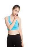 Asian healthy girl got shoulder pain Royalty Free Stock Photos