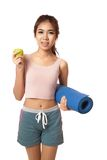 Asian healthy girl with green apple and Yoga Mat Royalty Free Stock Images