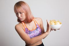 Asian healthy girl  hate potato chips, junk food. Royalty Free Stock Photography