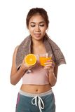 Asian healthy girl look at orange and orange juice Royalty Free Stock Images