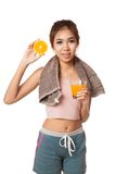 Asian healthy girl with orange  juice and orange Stock Image